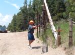 Rick Opening Gate to Rockin' E Ranch