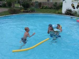 Rick Swimming with Nic & Jude in Hastings Nebraska