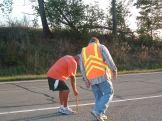 Rick Picking Up Roadside Coins