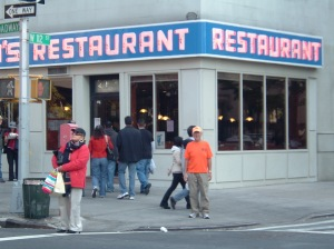 Rick Hammersley in front of Seinfeld Restaurant